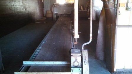 Explosives contaminated conveyor system